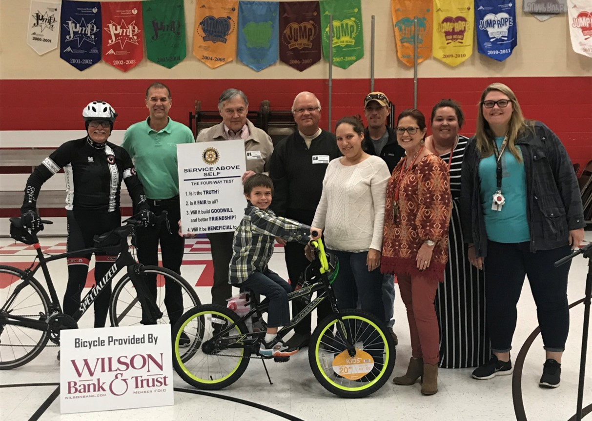 Ben Rice won a bike donated by the Hendersonville Rotary Club for living above the line!